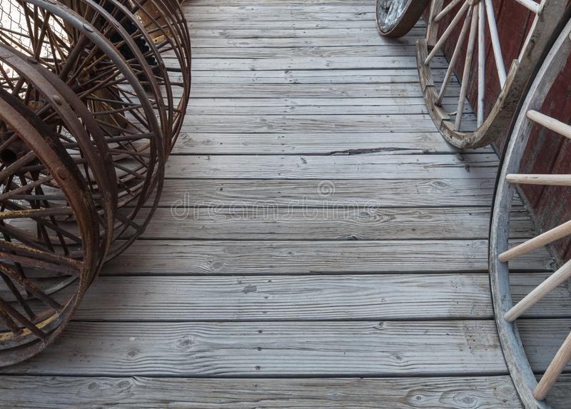 Old wheels on a wooden floor royalty free stock photo