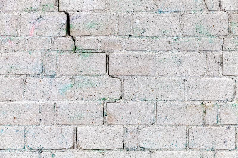 Old white brick wall with cracks stock photography