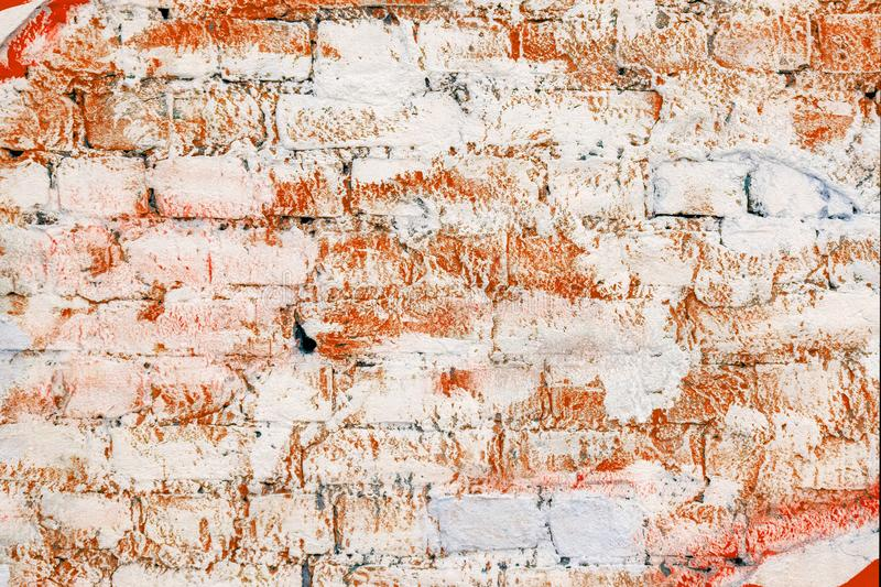 Old brick wall painted with red paint. Old white brick wall locally painted with red paint for text and disign royalty free stock photography