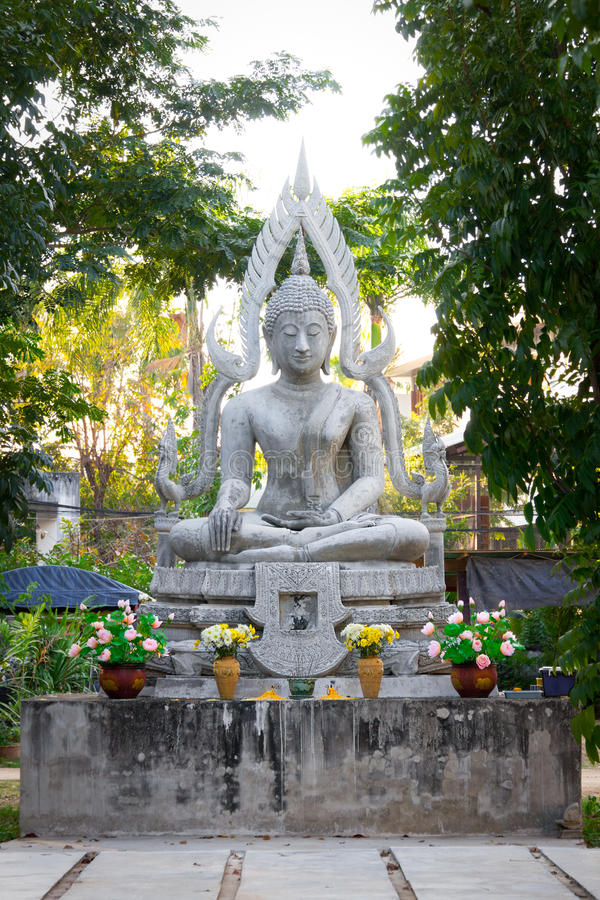 Old white buddha image in the garden royalty free stock photography