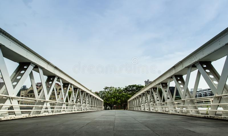Old white color metal bridge perspective view stock photo