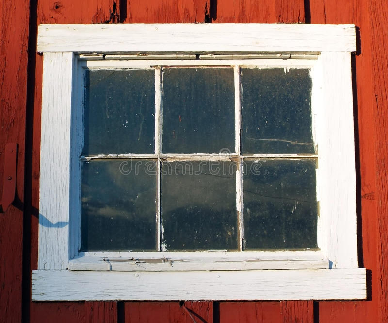 Old white framed window on red building stock images