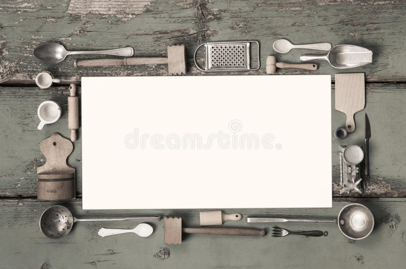 Old white kitchen message sign with cooking utensils for a frame. Old kitchen message sign with cooking utensils for a frame on ancient wood royalty free stock photo
