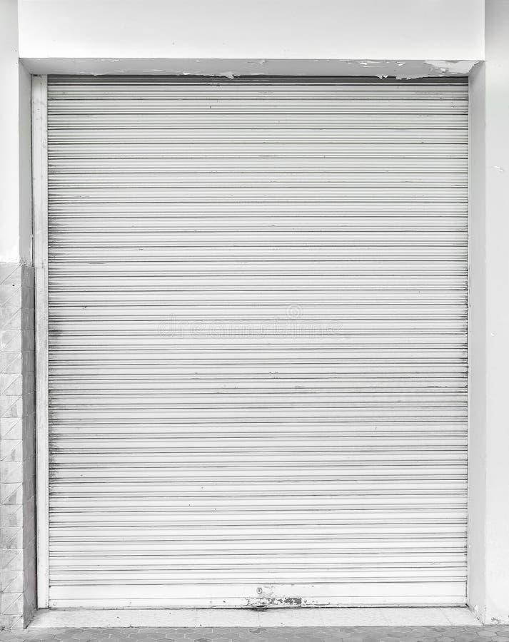 Old white metal roller shutter door. royalty free stock images