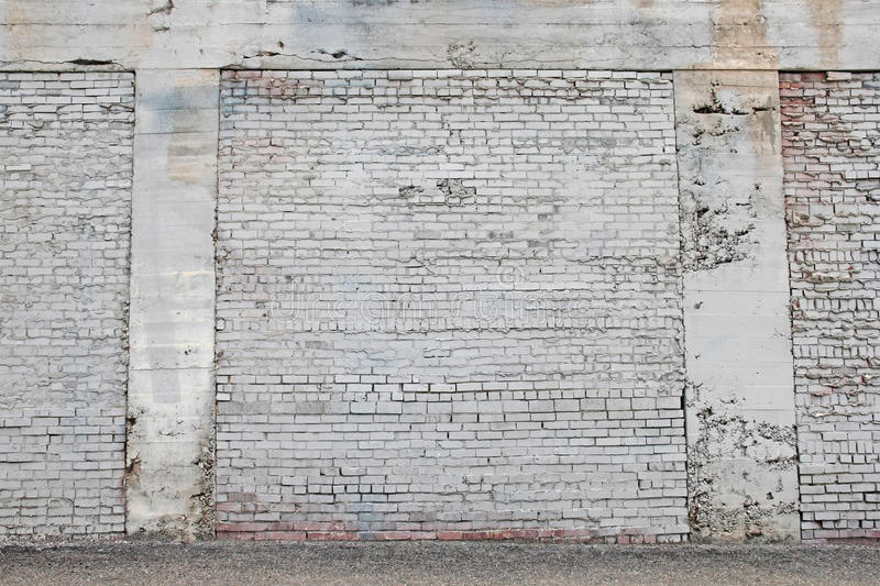 Old white painted brick wall with mortar background stock image