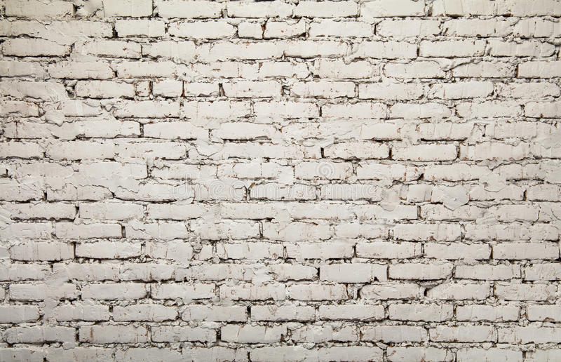 Old white painted grunge brick wall background royalty free stock images