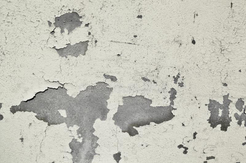 Old white painted wall, paint poured. Grey and white. Crack, broken royalty free stock image