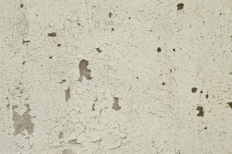 Old white painted wall, paint poured. Grey and white. Crack, broken royalty free stock photos
