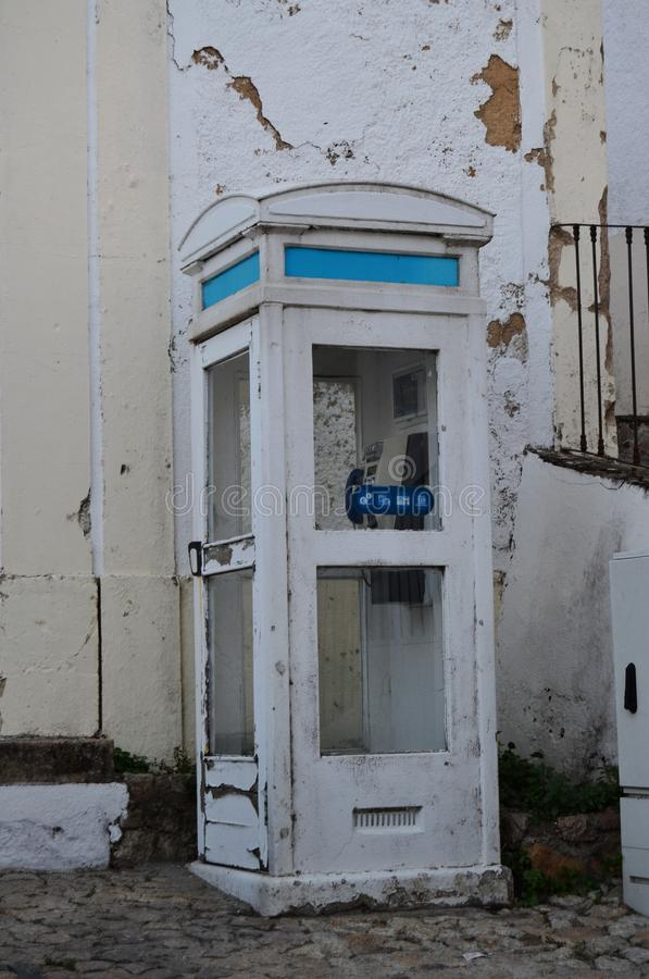 Old white telephone booth in Portugal royalty free stock photos