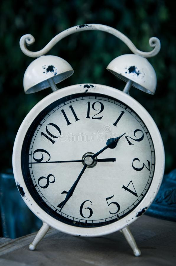 Old white vintage alarm clock stock photo