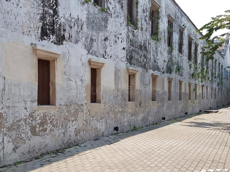 An old white wall and wooden windows stock photography