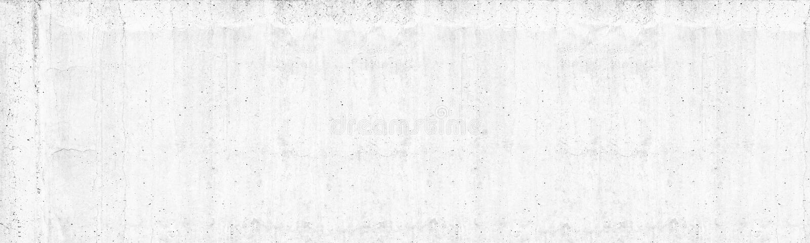 Old white concrete wall wide texture. Rough light gray cement surface panorama. Whitewashed panoramic background royalty free stock photos