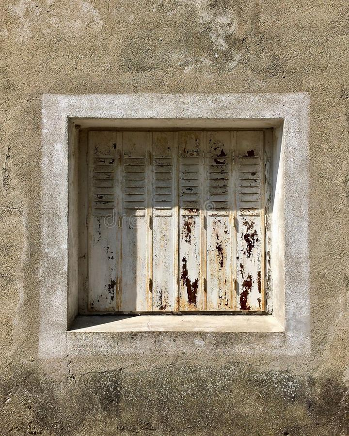 Old white window ruined by time royalty free stock photos