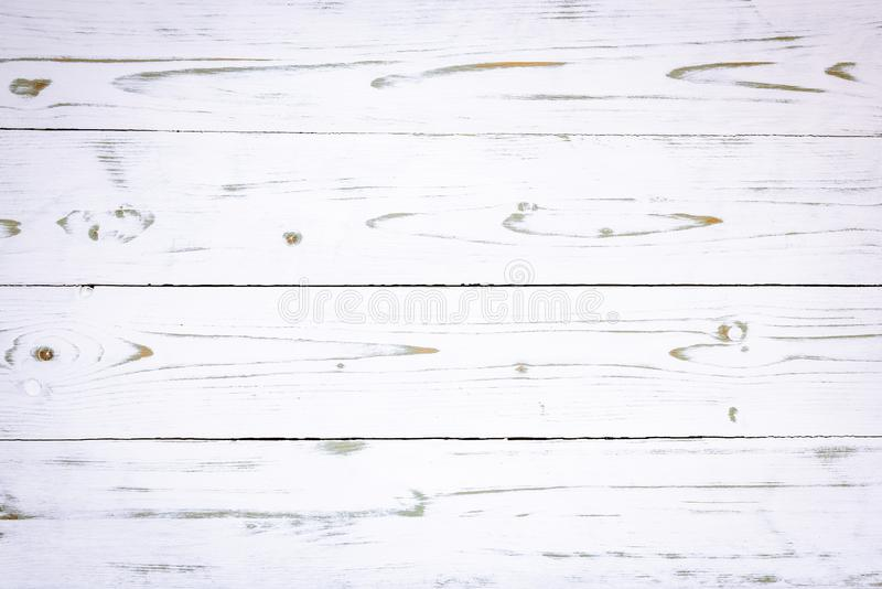 Old white wooden boards with beautiful grain. As background stock image