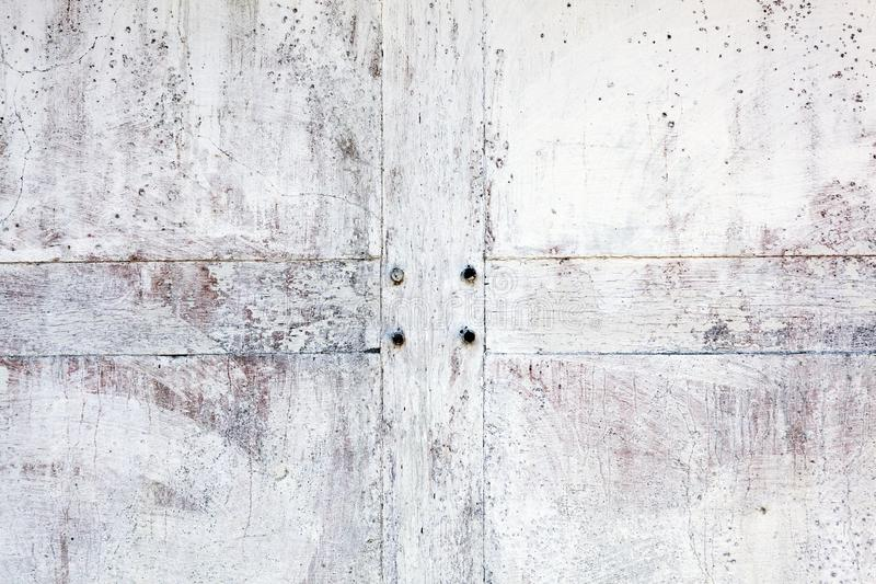 Old whitewashed weathered distressed cement stone and wood wall texture stock photo