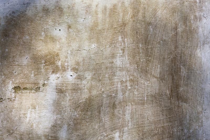 Old whitewashed weathered distressed cracked cement stone wall texture. Background stock photography
