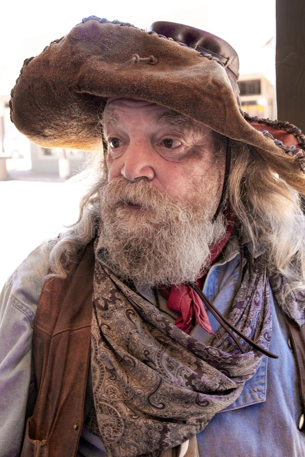 Old Wild West Cowboy Character. Old wild west cowboy miner character at annual cowboy event in Tombstone, Arizona stock photo