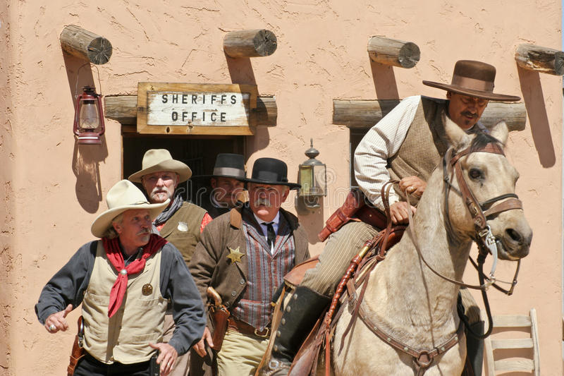 Old Wild West Gunfighters. Old West cowboy gunfighter actors on the old dusty town street during realistic reenactment at Old West History Festival in Arizona stock photos