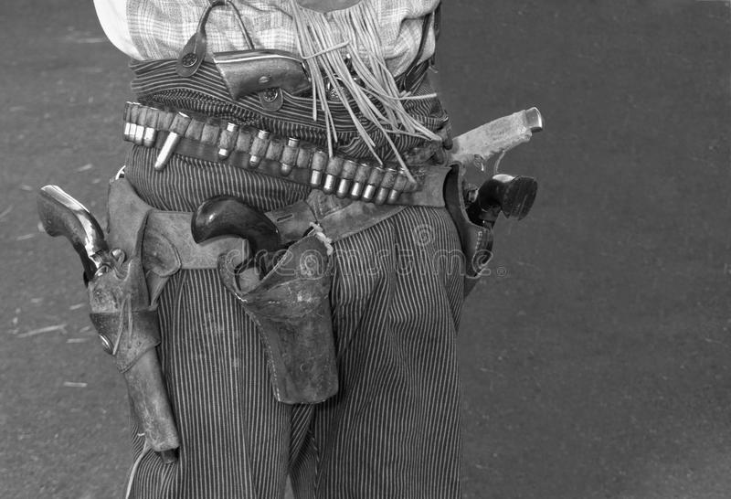 Wild West Outlaw Cowboy Guns and Holster. Old wild west outlaw cowboy wearing six shooter hand guns and a leather holster royalty free stock images