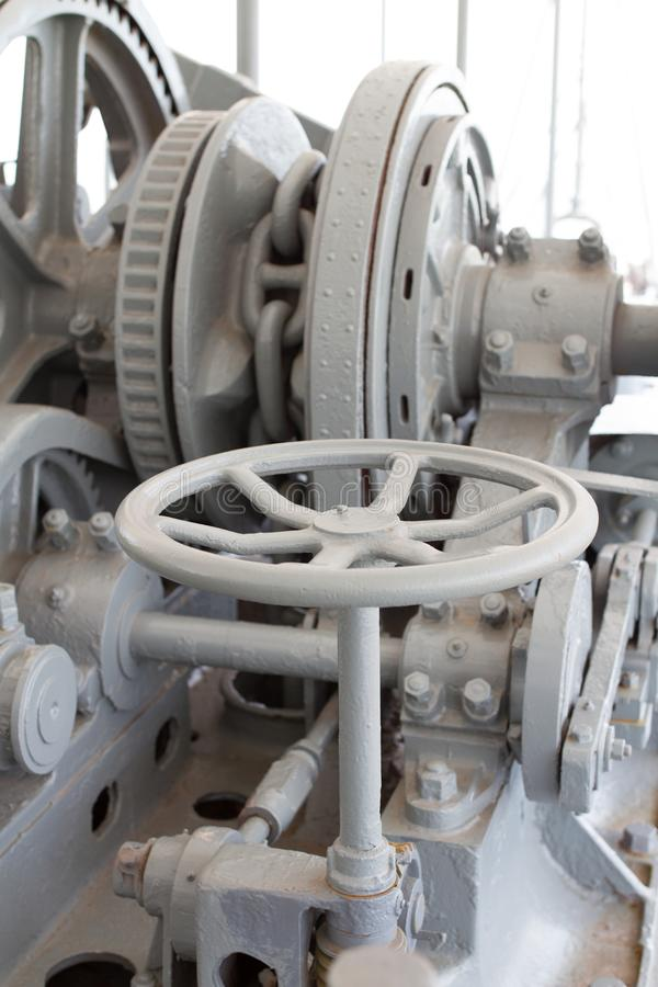 Old Winch lifting Mechanical Anchoring. Old Winch lifting Mechanical Anchoring of large ship have a big chain and gear cog royalty free stock images