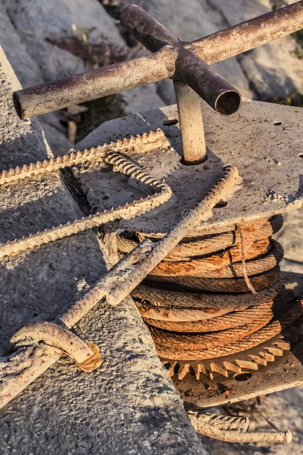 Old Winch With Rusty Gear Wheel And Corroded Steel Cable Coil Detail.  royalty free stock images