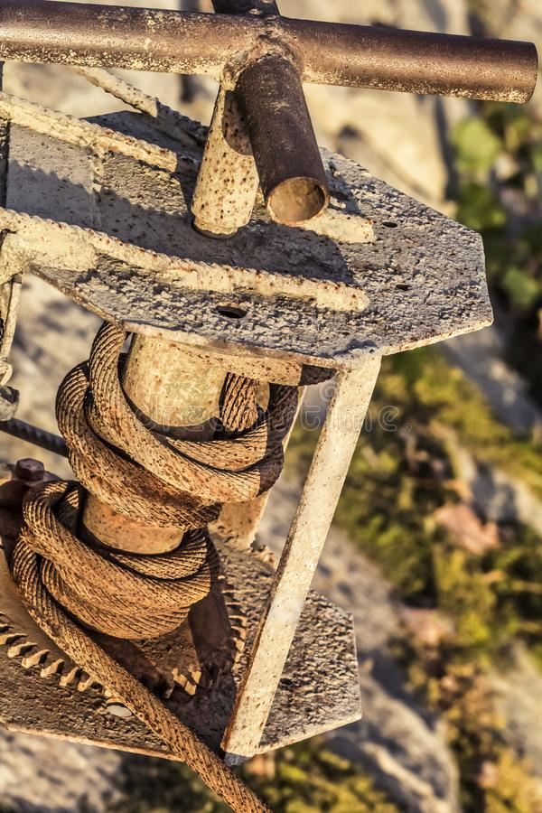 Old Winch With Rusty Gear Wheel And Corroded Steel Cable Coil Detail.  royalty free stock photos