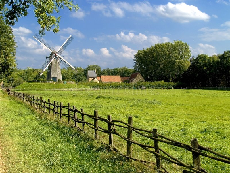 Old windmill, blue cloudy sky. stock photography