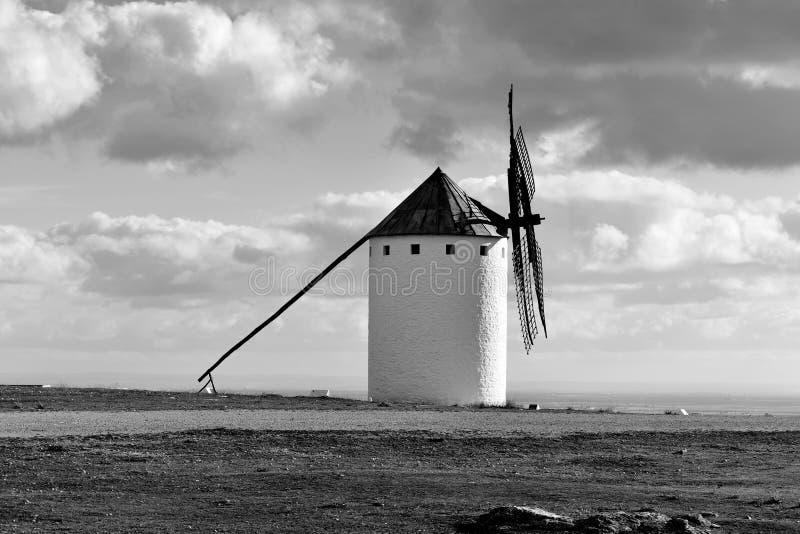 Old windmill in Campo de Criptana, Spain, black and white. A traditional white windmill in Campo de Criptana, Spain, in black and white royalty free stock photos