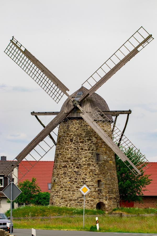 Old windmill by cloudy day, Europe, Germany stock image