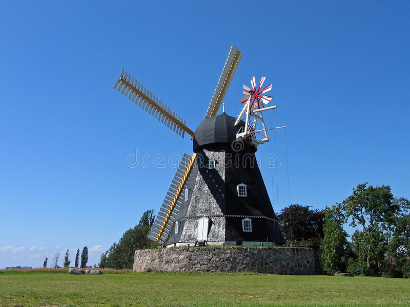 Old windmill in Denmark. Old traditional country windmill in Denmark royalty free stock image