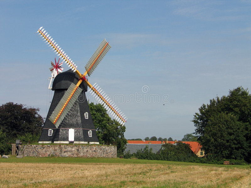 Old windmill Denmark. Old country windmill in a farm Denmark stock photos