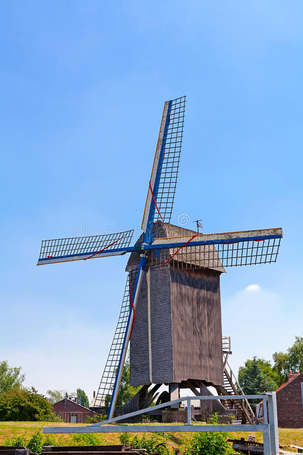 Old windmill in the field. Green grass, blue sky stock images