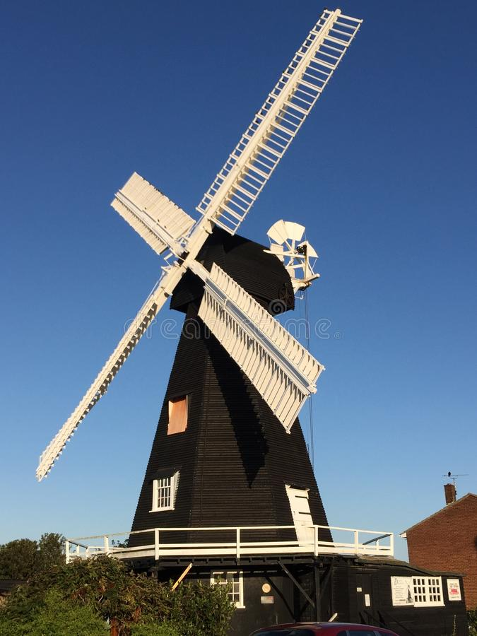 Free Old Windmill In Kent - Black With White Sails Stock Photo - 158187810
