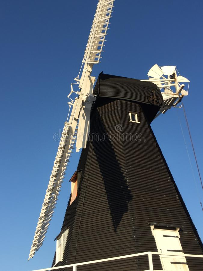 Free Old Windmill In Kent - Black With White Sails Stock Image - 158187811