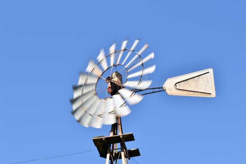 Old Windmill in Operation in a Blue Day royalty free stock image