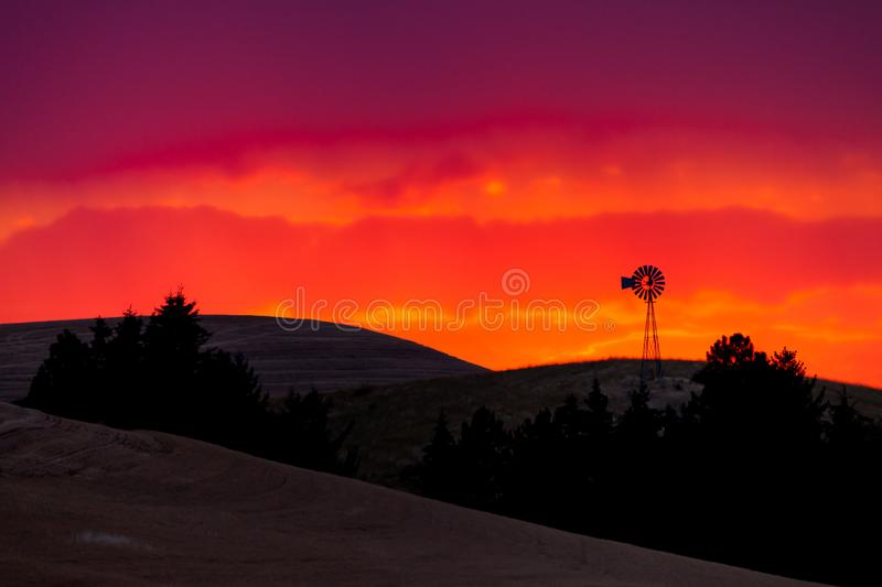 Old windmill in the Palouse of eastern Oregon at sunset. Old windmill in the Palouse of eastern Oregon, USA at sunset stock photography