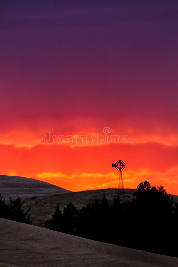 Old windmill in the Palouse of eastern Oregon at sunset. Old windmill in the Palouse of eastern Oregon, USA at sunset stock photo