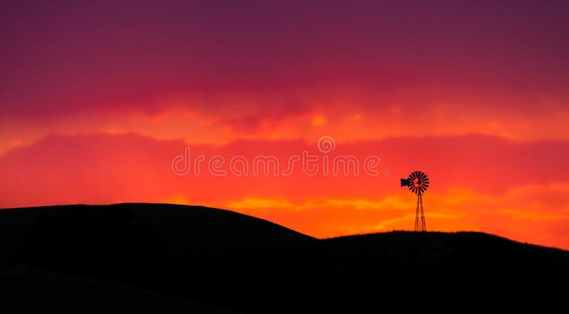 Old windmill in the Palouse of eastern Oregon at sunset. Old windmill in the Palouse of eastern Oregon, USA at sunset royalty free stock photos