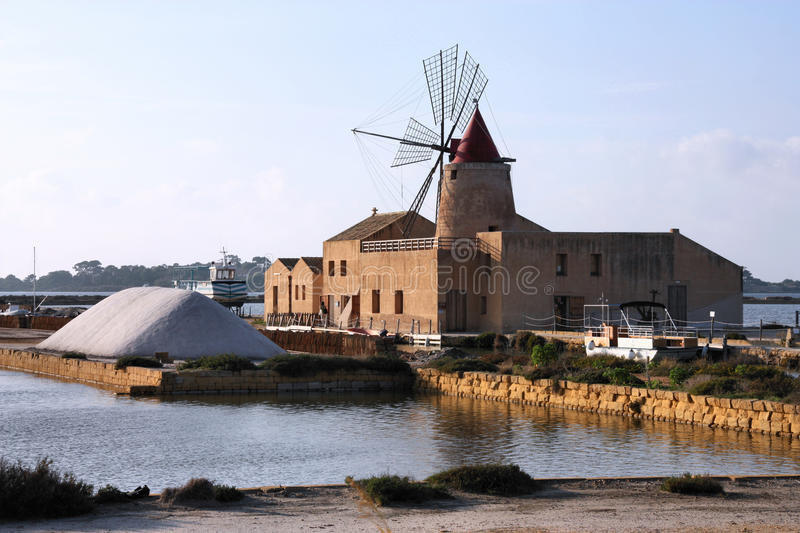 Old windmill in saltworks stock photo