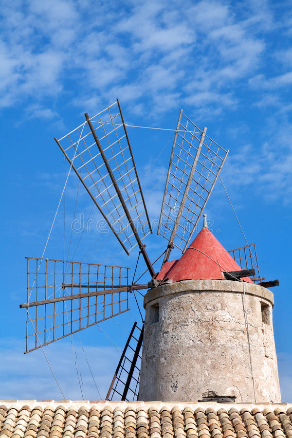 Old windmill on the saltworks in Trapani, Sicily, Italy royalty free stock photo