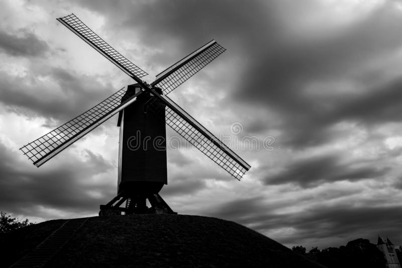 Old windmill silhouette in Bruges, Belgium stock photography