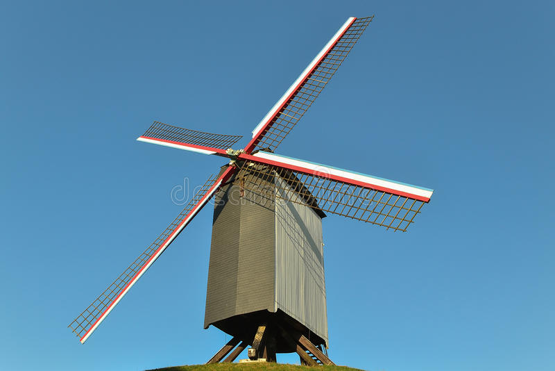 An old windmill sitting on the top of a hill in a small city in Belgium stock photos