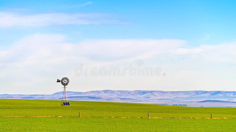 Old windmill with sloar batteries royalty free stock photography