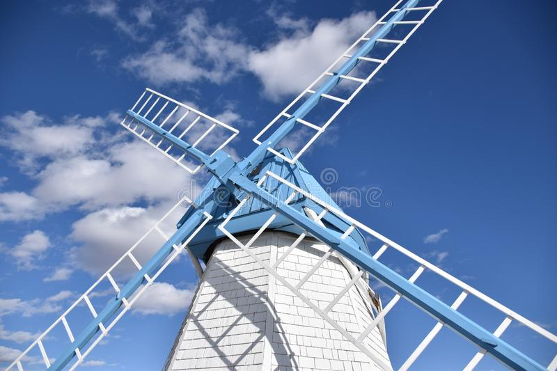 Blue and White. This old windmill was used to generate energy to grind rye stock image