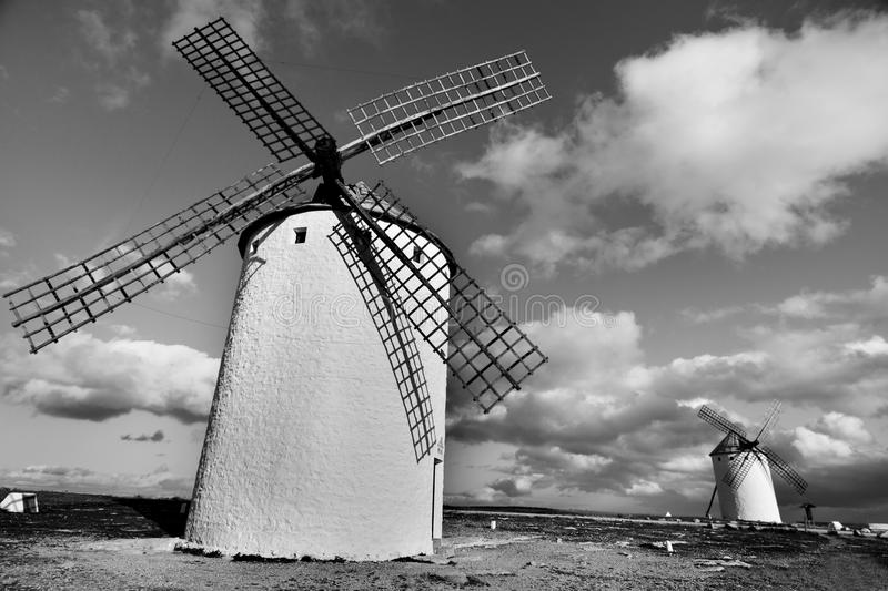 Old windmills in Campo de Criptana, Spain, black and white. Some traditional white windmills in Campo de Criptana, Spain, in black and white royalty free stock photo