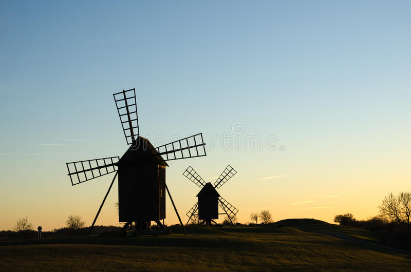 Old windmills in late evening sun royalty free stock image