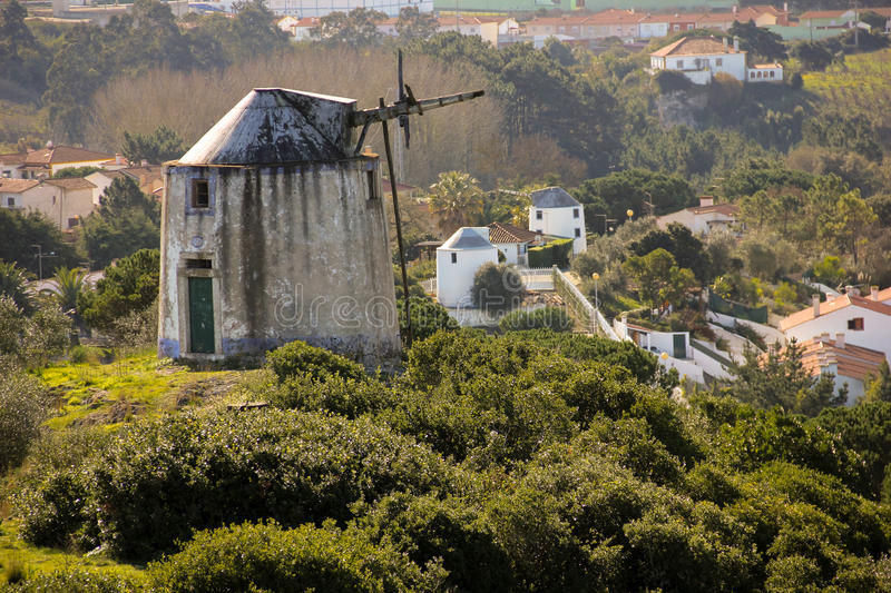 Old windmills. Obidos. Portugal. Old XIX century windmills without arms. Obidos. Portugal royalty free stock photos