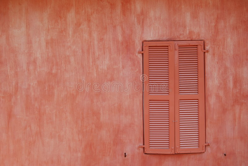 Old window. This is a shot of a really old wall with a window in the background royalty free stock photography