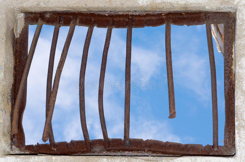 Old window. Closed by a rusty lattice royalty free stock images