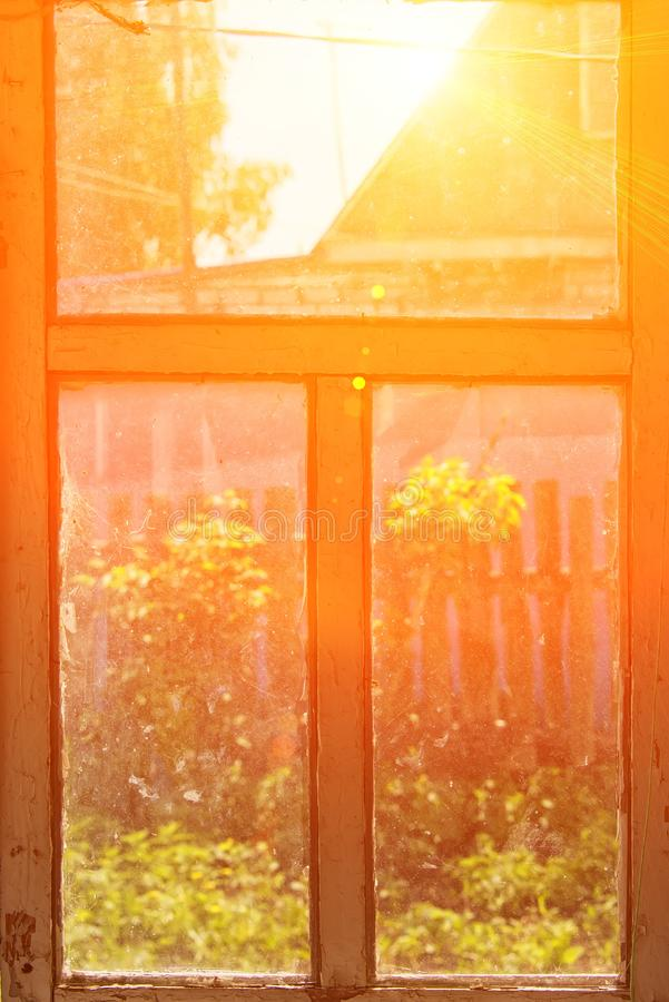 Old window in the bright sun from inside stock photo